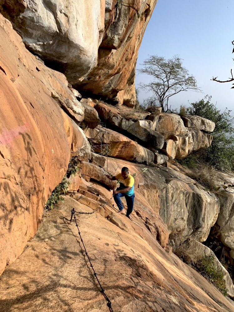 Traversing rocky slope at Tapaseshwara Betta
