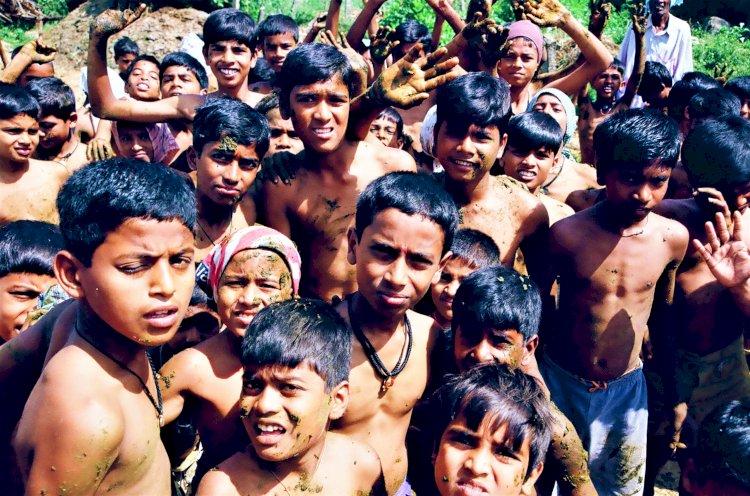 children having fun during faecal festival at gumtapura