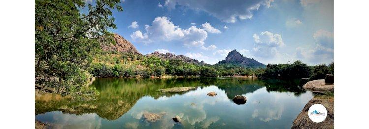 Reflection of Davalappana gudda in the Chandravalli lake